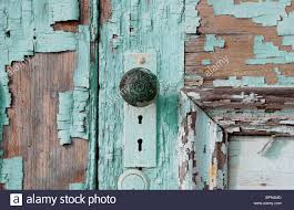 rustic wood door knob with chipping paint stock photo royalty
