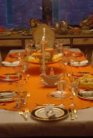 thanksgiving table cover glass window with brown color blinds along white blue brown