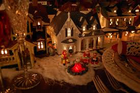 department 56 halloween village christmas table setting tablescape with dept 56 lit houses and