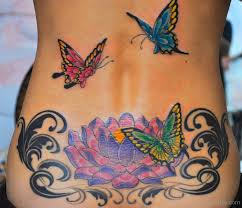 butterfly and hibiscus flower on lower back