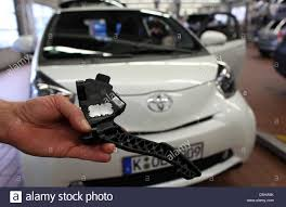 toyota garage a mechanic of toyota presents a throttle pedal of a toyota iq in