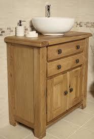 Oak Bathroom Cabinets by Classic Oak Bathroom Cabinets With Green Walls Bathroom
