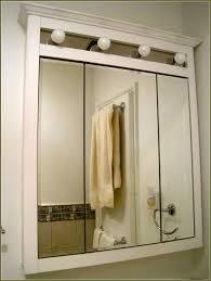 tri fold mirror bathroom cabinet proven tri fold medicine cabinet view with lights home design ideas