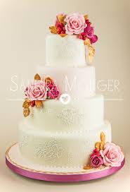 pastel pink and white lace wedding cake with sugar roses and gold