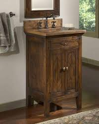 bathroom corner french country bathroom vanity featuring oval wall