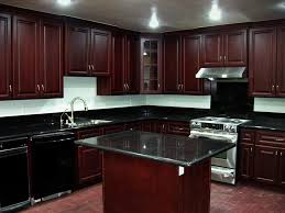 kitchen with cherry cabinets stainless steel under cabinet range