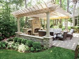 stonework accents this pergola for an outdoor seating area deck