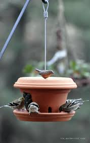 martini table with bird 40 fascinating things to make with clay pots bird feeder coops