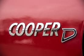 logo mini cooper driving fun to the power of four mini continues to expand its all