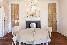 dining table in front of fireplace french dining room with fireplace and silver beaded mirror french