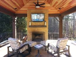 cozy cabana with in ceiling speakers a tv mounted over the stone
