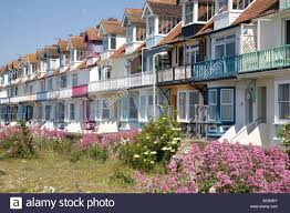 row of terraced houses on the beach front whitstable kent uk