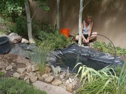 my santa fe garden water feature with pond and small waterfall