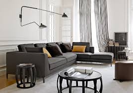 grey living room walls brown furniture rug along small mirror