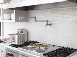 pot filler faucet installed in the kitchen wall over stainless