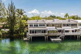 waterfront miami townhome on stilts seeks 700k curbed miami