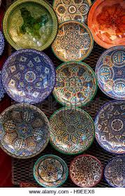 souvenir plates for sale in the medina asilah morocco stock