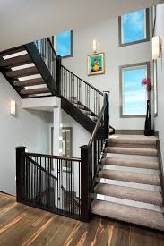 Dark Wood Banister Wrought Iron Spindles Staircase Contemporary With Artwork Carpet