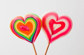 s day lollipops colorful heart shaped lollipops on grey background stock photo