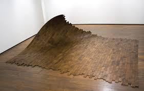 a wood sculpture made from flooring wood floor business