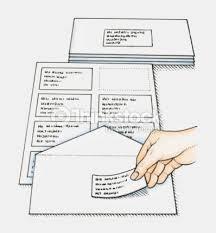 sticking preprinted address labels on envelopes stock