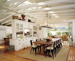 open view rustic dining room using wrought iron candle chandelier