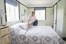 Bedroom With Bed In Middle Of Room How To Turn Your Bedroom Into A Sleep Cave Huffpost