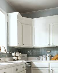 adding moulding to kitchen cabinets painting particle board