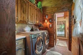 Kraftmaid Laundry Room Cabinets Rustic Laundry Room With Built In Bookshelf Wall Sconce In