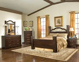 traditional bedroom furniture sorrento king poster bed with nightstand chest and drawer dresser with vertical mirror in bedroom