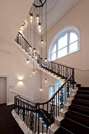 lighting floating bubble chandelier with wood staircase also
