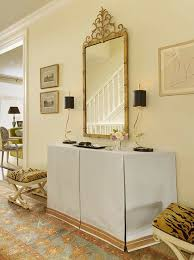 Gold Entry Table Chic Foyer With Gilded Mirror Over Skirted Console Table Filled