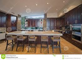 stools for island in kitchen spacious kitchen with stools at island in house royalty free stock