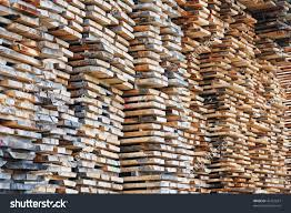 pile lumber near lumber mill waiting stock photo 46752637
