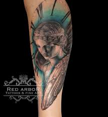 winged valkyrie tattoo by cory claussen tattoos