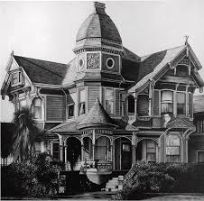 black victorian house stone and black iron victorian style hosue