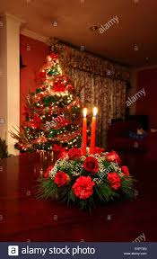 christmas table decoration with red roses carnations and candles