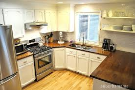 White Cabinets Subway Tile Walnut Butcher Block Countertops - White kitchen cabinets with butcher block countertops