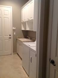 Storage Solutions Laundry Room by Casseletto Riverstone Naples Fl Laundry Room Organization And