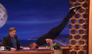 jamie dornan balances his body on conan u0027s desk with impressive