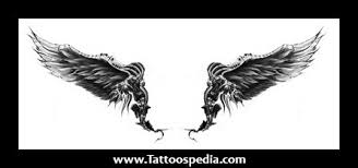lower back wing tattoos