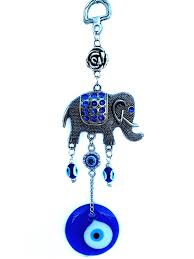 blue evil eye with an elephant hanging ornament for