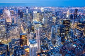 new york city skyline manhattan aerial view at night schneider