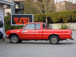 old red nissan pickup truck at gas station free images at clker