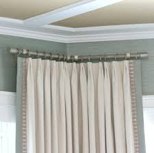 How To Put Curtains On Bay Windows How To Hang Curtain Rods For A Corner Window For The Home