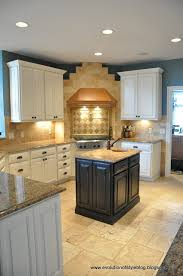 spraying kitchen cabinets how to paint your kitchen cabinets like a pro evolution of style