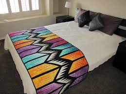 canton village quilt works quilts on the bed