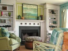 fascinating living room with artworks as fireplace mantel decor