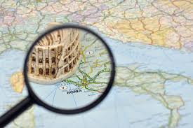 rome on a map rome on italy map miniature souvenir colosseum stock image