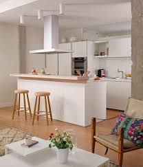 modern open plan kitchen design with mini bar and wooden stools
